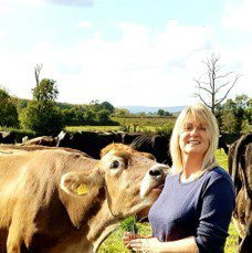 Free Range Dairy   Jenni with curious cow